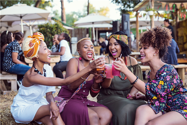 A group of women toasting at the Fourways Farmers