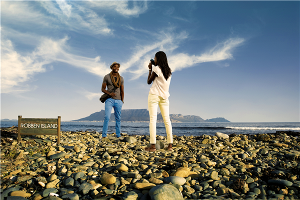A young couple taking photos on Robben Island