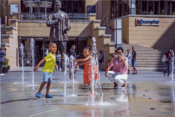 Children playing in the fountains on Nelson Mandela