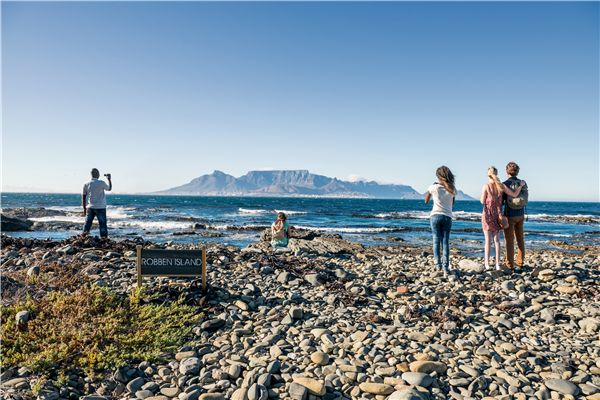 People looking at Table Mountain from Robben Island